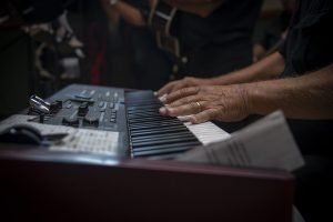 playing a keyboard in a band